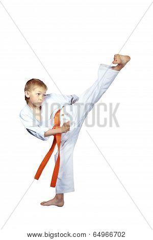 The blow Yoko-geri is doing  athlete on a white background