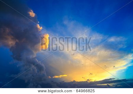 Dramatic Sunset Sky With Yellow, Blue And Orange Thunderstorm Clouds.