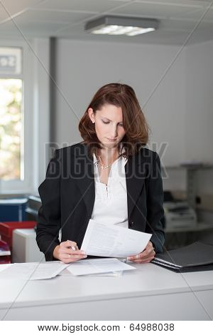 Young Businesswoman Checks Contract