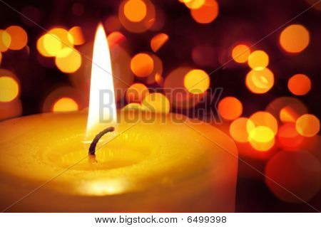 Candle And Blured Lights In The Background