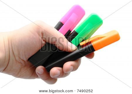 Three color markers in a hand of the designer
