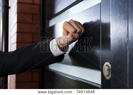 Hand Knocking On The Door