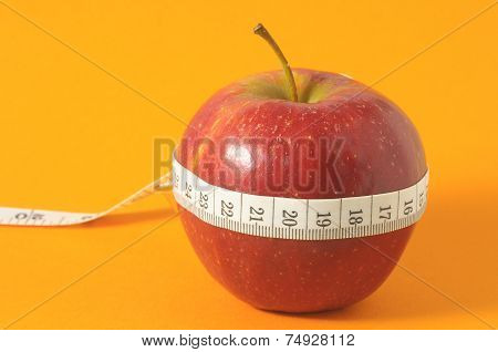 Measuring Tape Wrapped Around a Red Apple as a Symbol of Diet poster