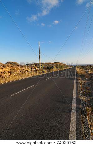 Asphalt Road in the Desert on a Colored Sunset poster