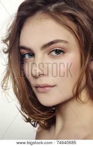Portrait of young beautiful sexy girl with clean make-up and messy hairdo