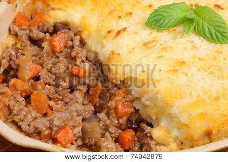 Freshly baked shepherds pie in casserole dish.