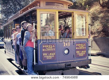 Passengers Riding Cable Car In San Francisco
