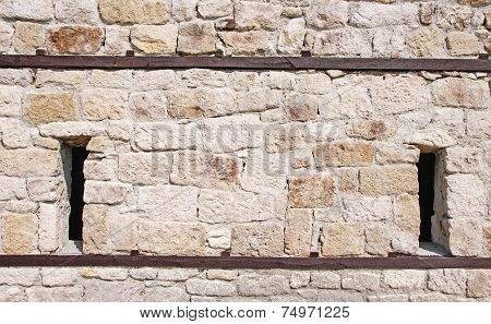 Stone Wall With Embrasures And Wooden Beam