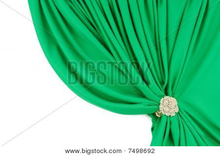 green silk curtains with a clip