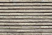 Modern Wall From rectangular Granite Blocks. Background and Texture for text or image. poster