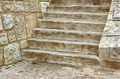 Old Wooden Staircase and stone wall. Background and Texture for text or image. poster