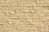 Beige Artificial Stone Wall. Background and Texture for text or image. poster