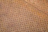 Rusted steel sheet with diamond pattern background texture poster