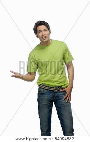 Portrait of a surprised young man gesturing