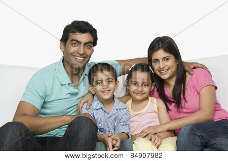 Portrait of a happy family sitting on a couch