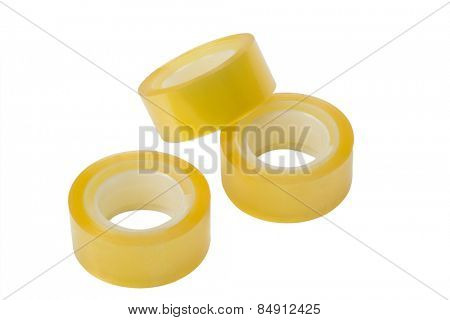 Close-up of three rolls of adhesive tapes