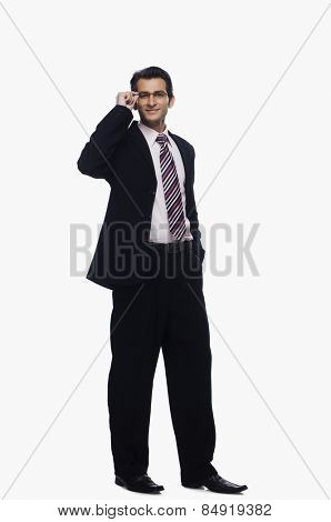 Portrait of a businessman adjusting his eyeglasses