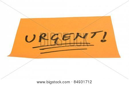 Word Urgent written on an adhesive note