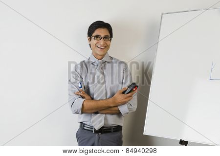 Portrait of a teacher smiling in front of a whiteboard