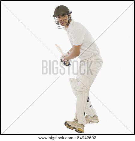 Cricket batsman with a high back lift
