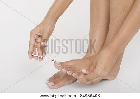Woman clipping her toenails