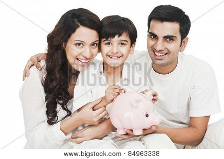 Portrait of a happy family with a piggy bank
