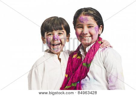 Portrait of brother and sister celebrating Holi festival poster