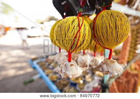 Coconuts tied up with threads at a market, Shani Shingnapur, Ahmadnagar, Maharashtra, India poster