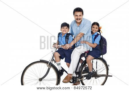 Man with his children on a bicycle