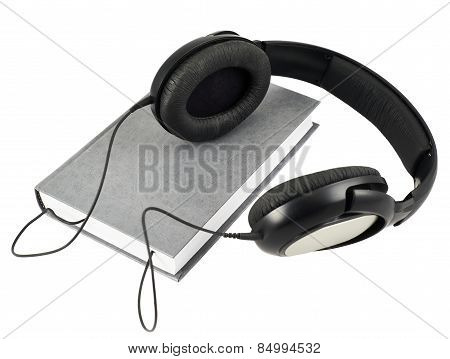 Headphones over a book composition