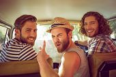 Hipster friends on road trip on a summers day poster
