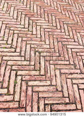 Fishbone-patterned red bricks pavement