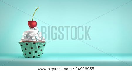 Delicious cupcake topped with a cherry and sweeties.