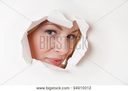 young woman peeking