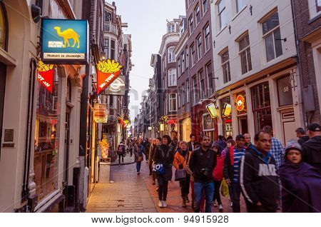 Amsterdam, Netherlands - May 8, 2015: People Visit Red-light District In Amsterdam.
