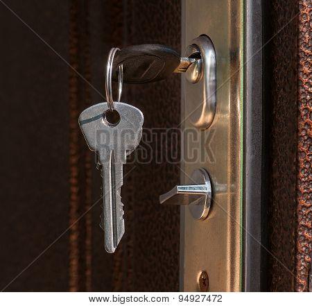 The Keys In The Lock Of A Metal Door