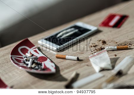 Close up on cigarette and lines of cocaine poster