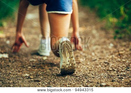 closeup runner shoe on park trail