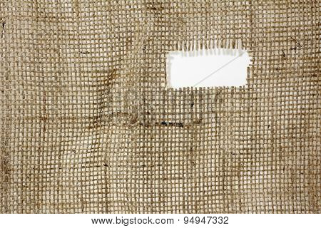texture of Burlap hessian hole with frayed edges on white background poster