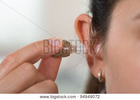 Female Hand With Hearing Aid
