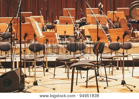 Orchestra Stage With Chairs And Microphone