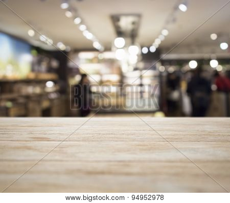 Table top counter with Blurred Retail shop Interior decoration background