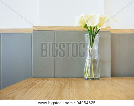 White Calla Lily Flowers In Glass Vase On Table Home Decoration