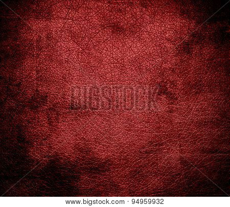 Grunge background of auburn leather texture