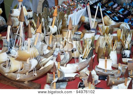 Market stall selling souvenir ships.