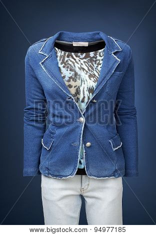 Womens Jacket On A Manequin Isolated On A Blue Background.