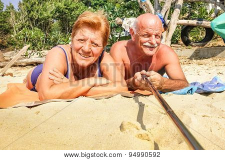 Senior Happy Couple Taking Selfie With Stick In Thailand Trip - Adventure Concept Of Active Elderly