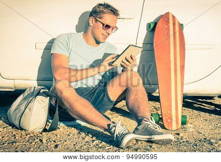 Young Hipster Man With Tablet Sitting Next His Car - Concept Of Modern Technologies