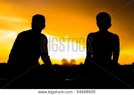 Two Silhouettes At Sunset