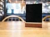 Mock up Menu frame on Table in Bar restaurant cafe poster